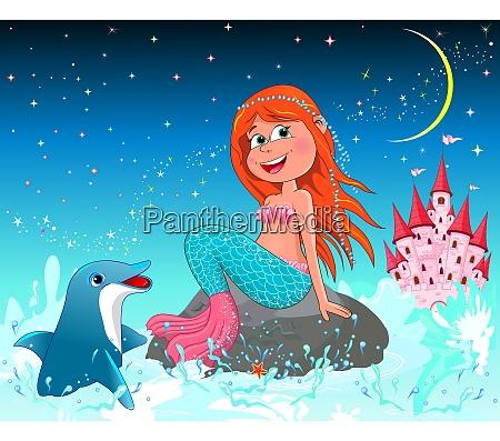 suesse freudige kleine meerjungfrau und delphin