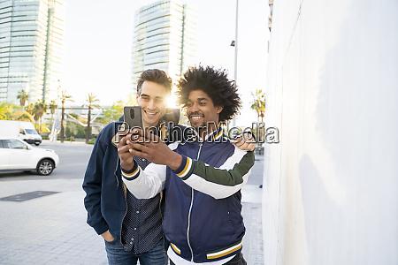 two happy friends taking a selfie