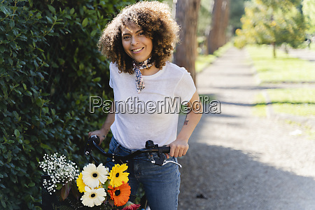 portrait of smiling woman with flowers