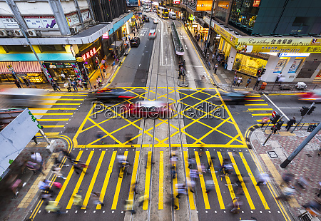 pedestrians crossing road in hong kong