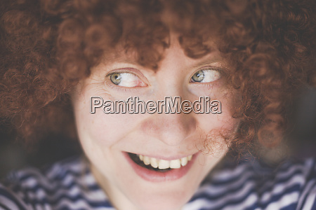 portrait of smiling woman wearing a