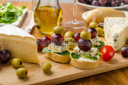 delicious blue cheese with olives grapes
