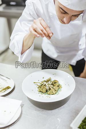 junior, chef, prepairing, a, dessert, on - 27117007