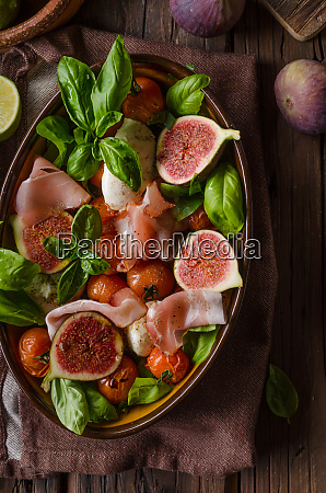 homemade fresh figs salad with herbs