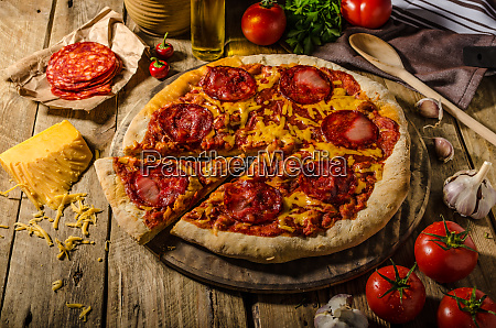 rustic salami pizza with cheddar cheese