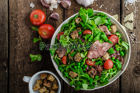 fresh salad with bacon and croutons