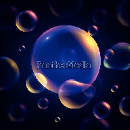 colorful transparent soap bubbles on dark