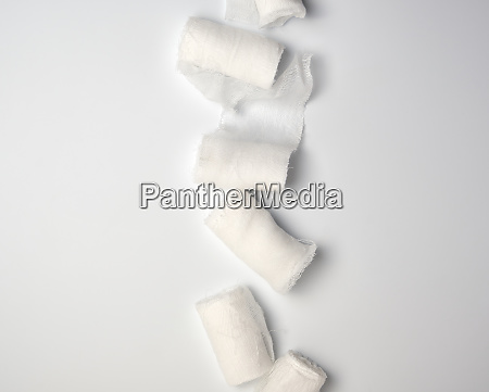 rolled up white sterile medical bandages