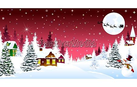 weihnachts winternacht ueber einem schneebedeckten dorf