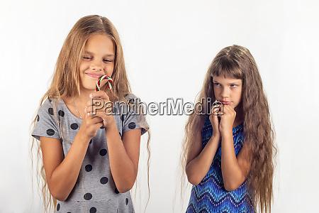 one girl has a lollipop in