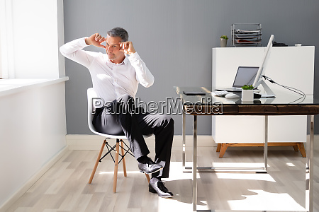 happy businessman stretching