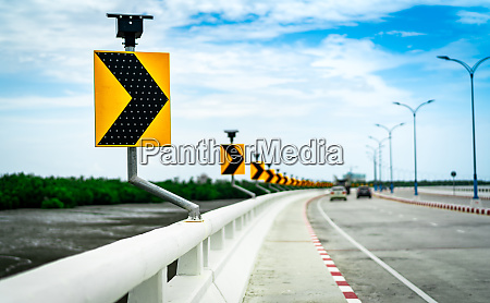 black and yellow arrow on curve