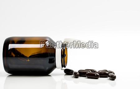 schwarze hartgelatine kapsel pillen und bernstein