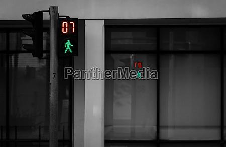 pedestrian signals on traffic light pole