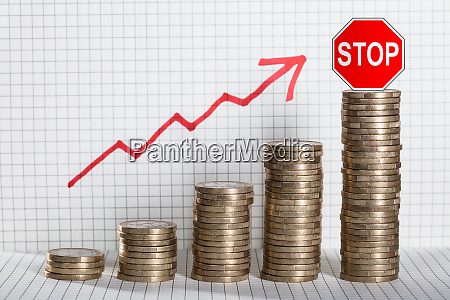 business graph with arrow and coins