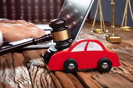 red car on desk in courtroom