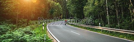 bike auf long curvy forest road