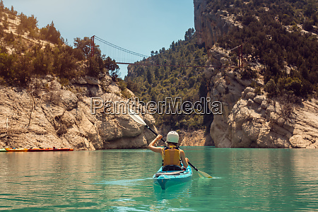 woman in kayak on a river