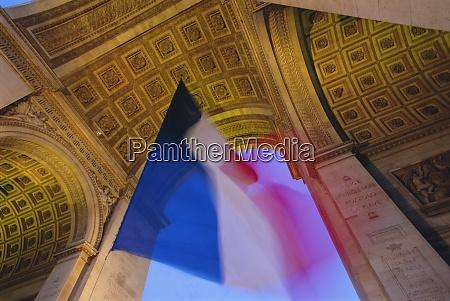 french flag flying at dusk arc