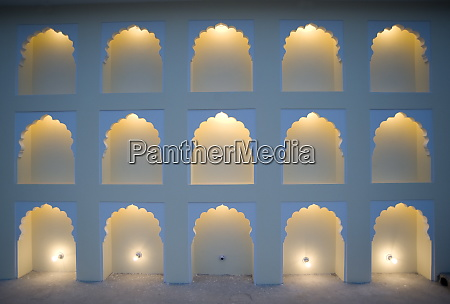 wall with arches lit one light