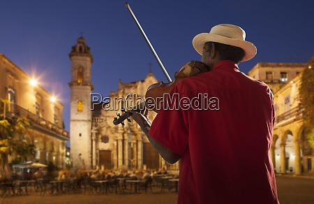 senior, man, playing, violin, at, night - 27271458