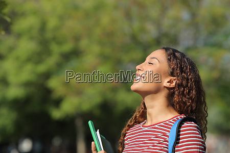 happy mixed race student breathing fresh
