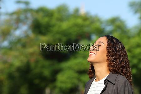 happy mixed race woman breathing fresh