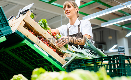 woman working in a supermarket sorting