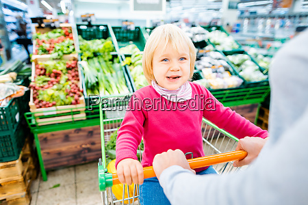 mother and toddler with shopping cart