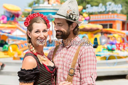 couple having fun on bavarian fair