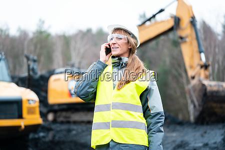 worker woman in open cast mining