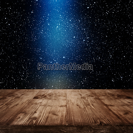 stars on night sky with wooden