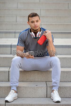 smartphone young latin man runner jogger