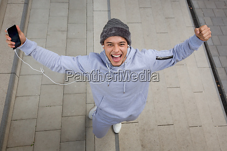 successful happy young latin man runner