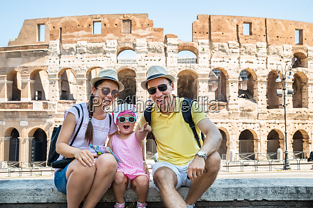 young family sitting in front of