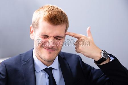 man making shooting geste