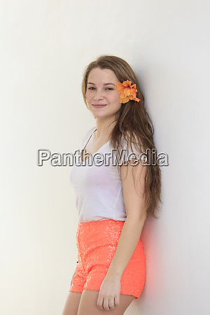 smiling young woman leaning against a
