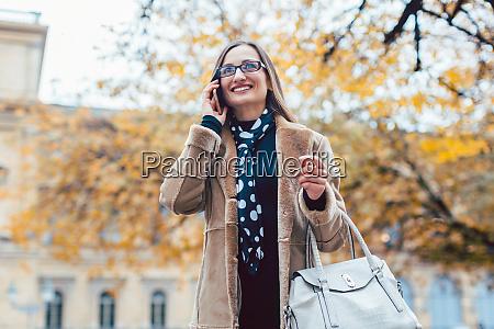 beautiful woman using her phone in