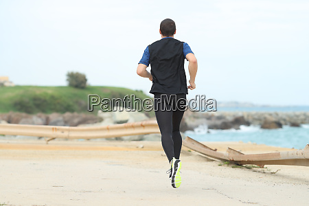 back view of a runner running