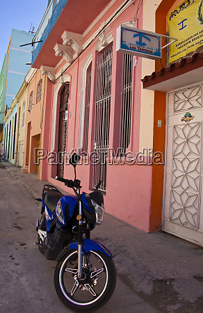 havana cuba a bright blue motorbike
