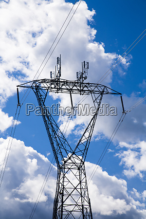 electric power lines against a blue