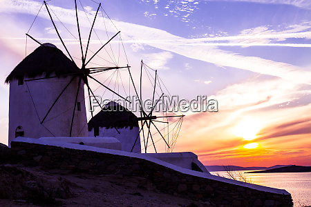 mykonos greece two windmills with a