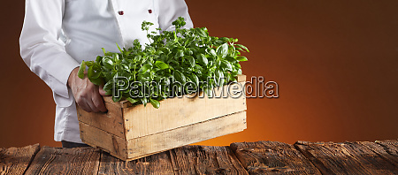 chef carrying a crate of fresh