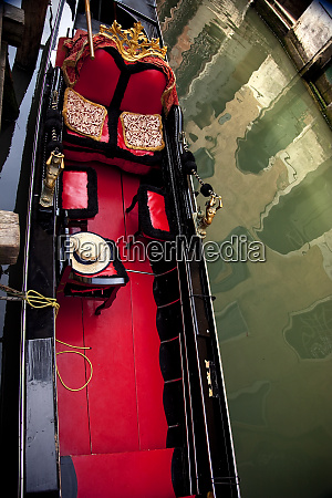 small canal red black gondel close