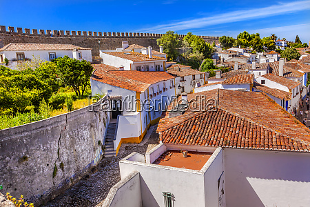 castle walls narrow street medieval town