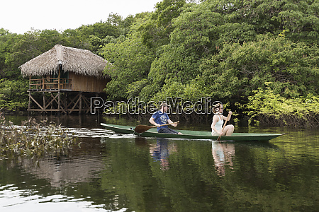 tourists, canoe, in, the, amazon, river - 27335771