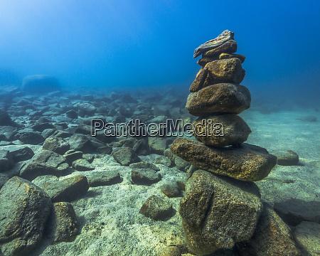 underwater stone cairn in lake tahoe