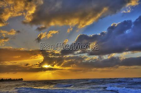 usa hawaii oahu sun setting over