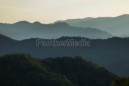 mountain ridges layered through this sunset