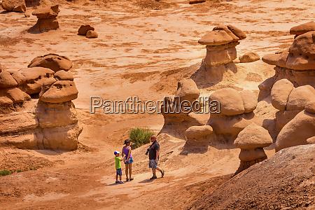 family walks among goblins mushroom shaped